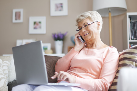 woman relaxing: Using from new technology is easier and faster