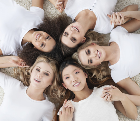 Beautiful multi ethnic girls lying in circle Stock Photo