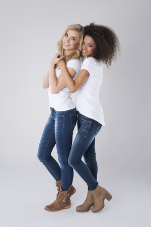 two women hugging: Blonde girl with her friend from Africa