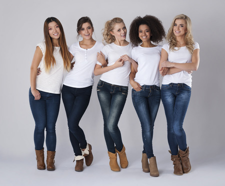 Multi ethnic friends wearing jeans and white t-shirts