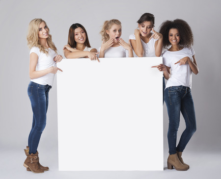 in behind: Multi ethnic group of women with empty whiteboard