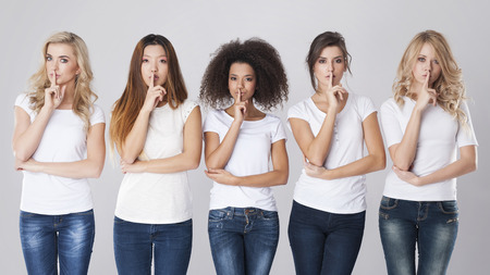 Multi ethnic women with silence sign photo