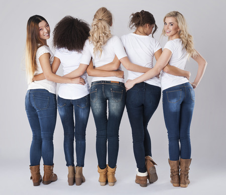 girl boots: We love wearing good jeans Stock Photo
