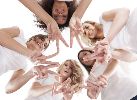 directly below: Girls hands forming a star shape Stock Photo