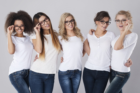 casual fashion: Beautiful girls wearing fashion glasses Stock Photo
