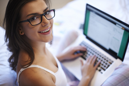 Happy woman with laptop photo
