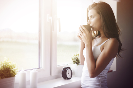 woman think: What a great way to wake up! Stock Photo