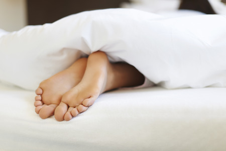 Close up of female feet in bed