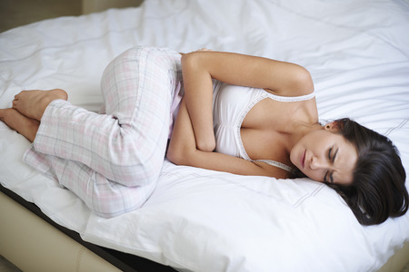 lying on stomach: Huge morning pain of stomach Stock Photo