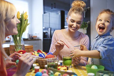 creative egg painting: Happiness from decorating Easter eggs Stock Photo