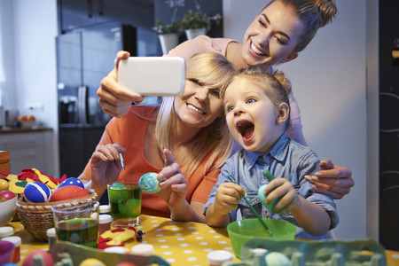 celebrations: Family selfie with easter eggs Stock Photo