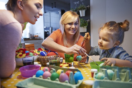 Painting Easter eggs with family photo