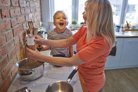 happier: Cooking together make us happier Stock Photo