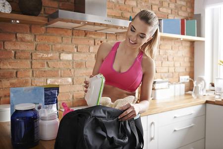 sports clothing: Preparing gym bag at home Stock Photo