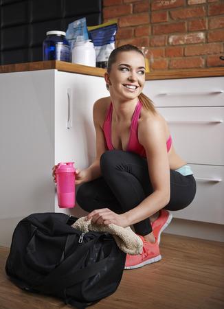 She always has protein drink in her gym bag 版權商用圖片