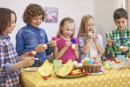 creative egg painting: Painting Easter eggs Stock Photo