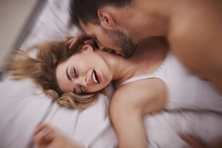sex on bed: Reaching new heights of ecstasy Stock Photo