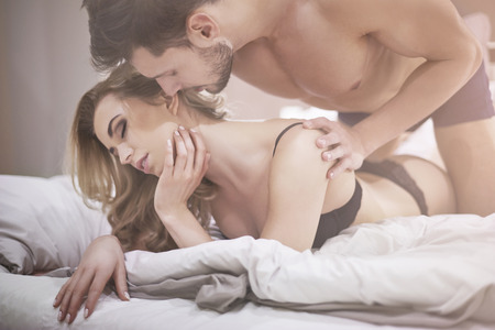 sex couple: Erotic moments of couple in bed