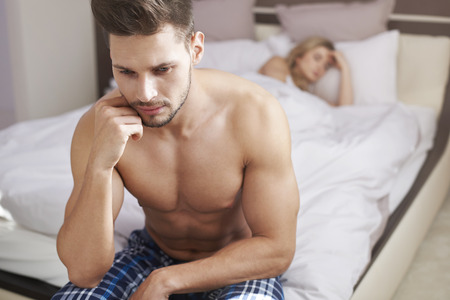 couple bed: Is she a good woman for me? Stock Photo