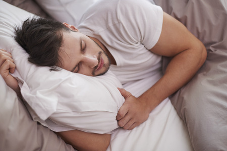 man with beard: Tired man resting in the bed Stock Photo