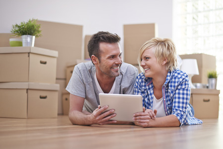 family moving house: Happy couple in new house