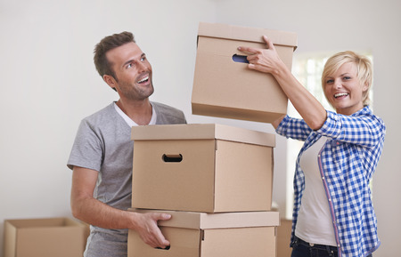 Happy couple finished packing in new house photo