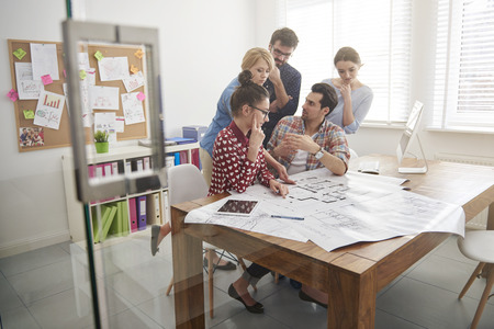 architect office:  Business team having brainstorming together