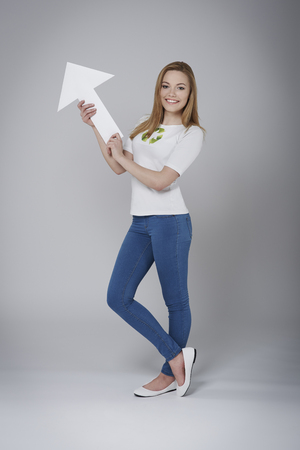 activist: Female activist for recycling pointing at copy space Stock Photo