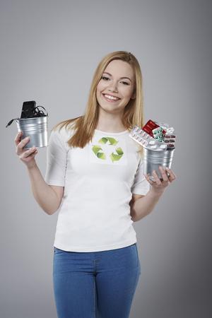 activist:   Female activist holding a waste stuff