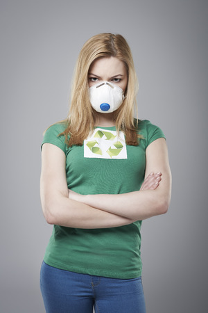 dust mask: Angry woman wear in protective mask Stock Photo