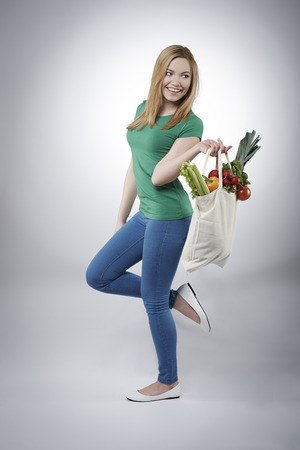 woman holding bag: Woman with healthy food