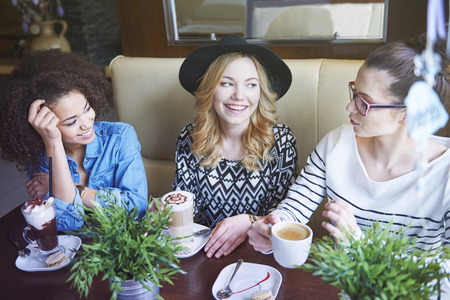 women coffee: Three friends in the cafe