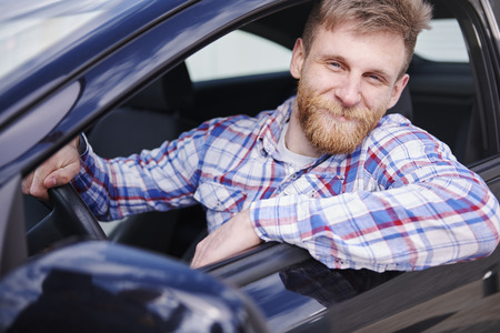 man looking out: He is proud from first car