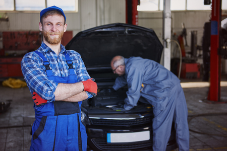 An experienced friendly and efficient mechanic of cars photo
