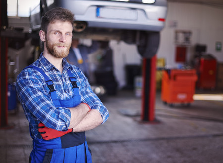 business smile: He is the best car mechanic in town