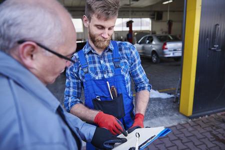 Planning monthly duties of cars mechanics photo