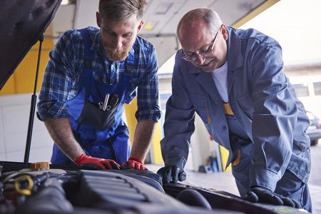 Professional mechanics at popular autoworkshop photo