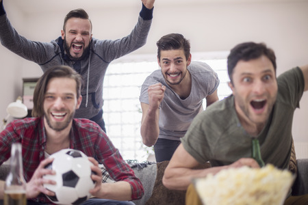 joy: Group of men support the favorite football team Stock Photo