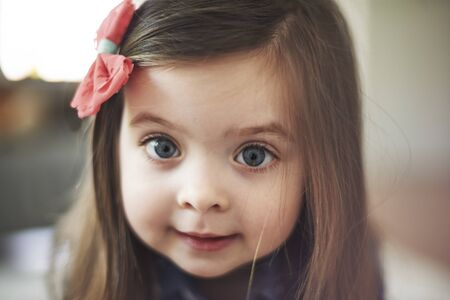 hair bow: Portrait of cute little girl with big eyes Stock Photo