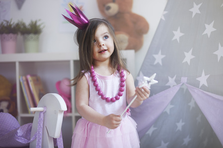 laughing girl: Dreams about being princess comes true Stock Photo
