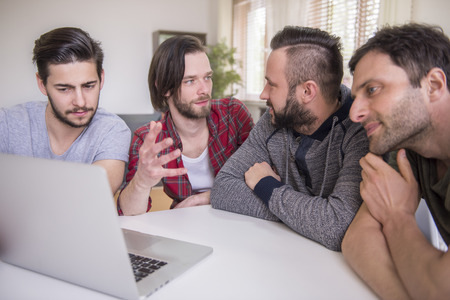 only men: Collaboration of young but very creative men Stock Photo