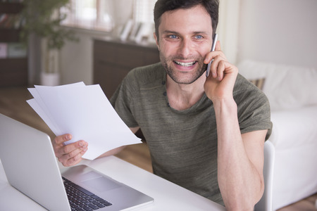 working space: He take care about his business Stock Photo