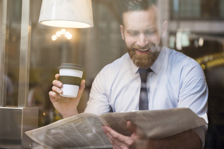 joy of reading: Enjoying the free time for coffee and some news Stock Photo