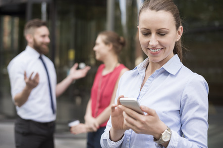 social networking: Quick phone during the meeting with investors Stock Photo