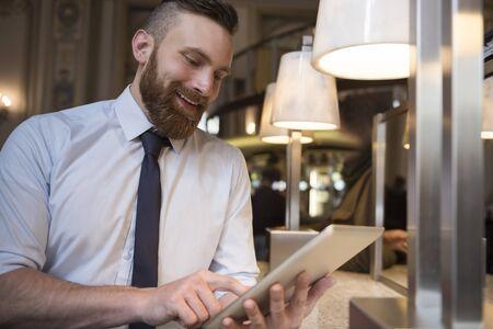 busy beard: Enjoying the success of my company Stock Photo