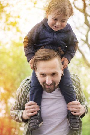 run faster: Run daddy! Run! Faster! Stock Photo