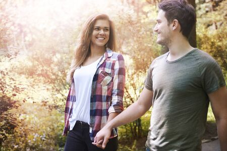affectionate actions: We can just walking and enjoying Stock Photo
