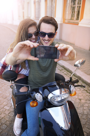 affectionate actions: Selfie goes first and than a ride Stock Photo