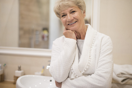 beautiful mature woman: Vital senior woman in the bathroom