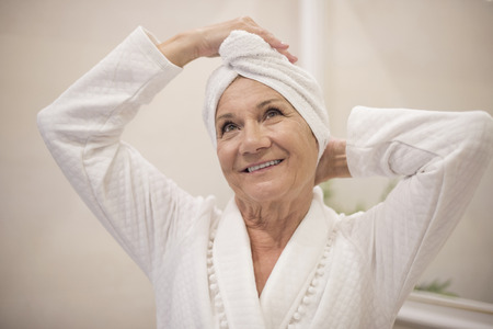 shower head: Senior woman at the Spa Stock Photo